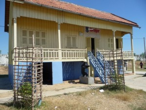 The freshly painted school with new classrooms and fruit trees